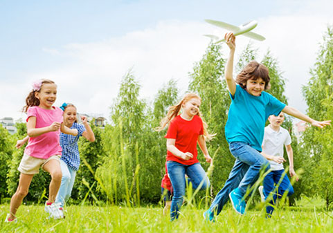 Photo of children playing outdoors